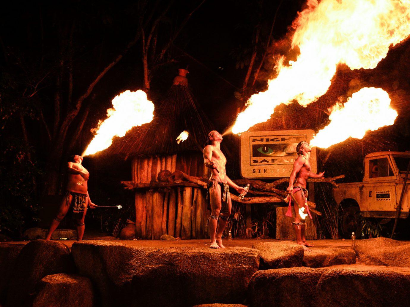 Arts + Culture Singapore Southeast Asia Trip Ideas Nature fire smoke outdoor flame light night campfire Entertainment heat bonfire darkness tradition performance art recreation dark fun fête performing arts engine