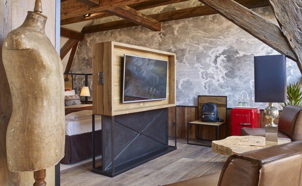 Budapest europe Hotels Hungary floor indoor Living Fireplace room interior design living room home ceiling beam loft furniture stone wood