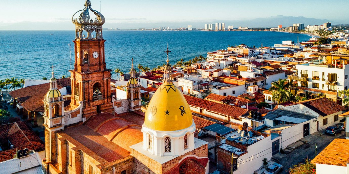 Food + Drink Mexico Puerto Vallarta City Town sky tourism Sea tourist attraction cityscape tower travel roof Coast