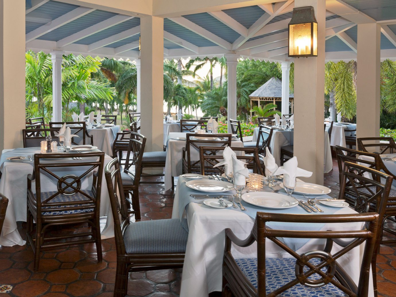 All-Inclusive Resorts Beachfront caribbean Dining Drink Eat Family Travel Hotels Island Romance Romantic Tropical table floor chair indoor property room dining room restaurant window Resort estate meal home porch furniture Villa real estate interior design cottage outdoor structure area set dining table
