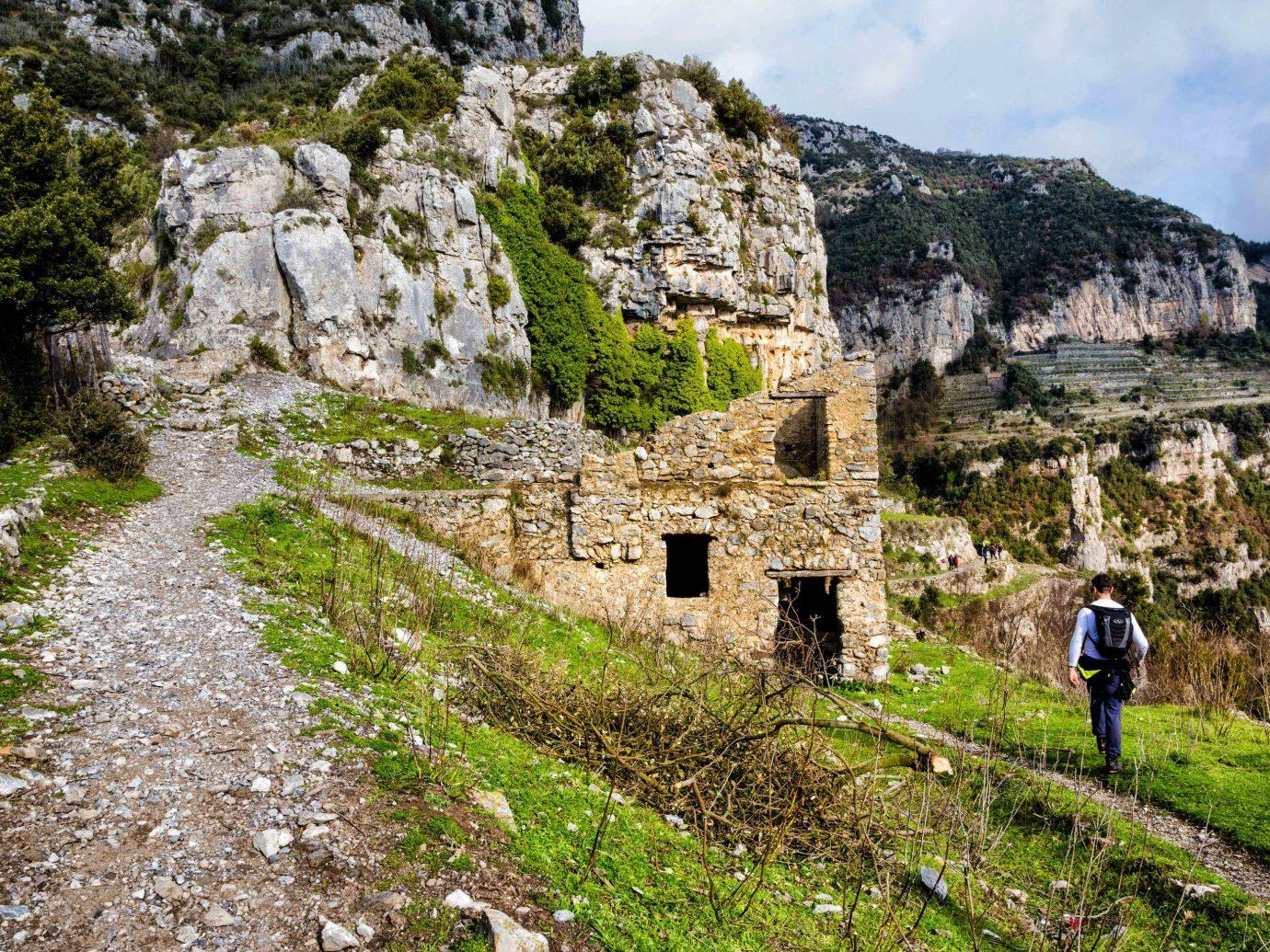 europe Outdoors + Adventure Trip Ideas mountain rock geological phenomenon sky Ruins mountain range Village escarpment grass geology landscape ancient history tree outcrop alps tourism