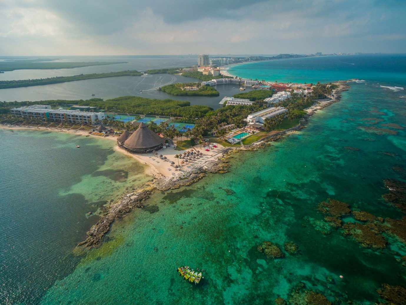 All-Inclusive Resorts Family Travel Hotels coastal and oceanic landforms Sea waterway Coast water resources promontory aerial photography Island bird's eye view islet headland cape archipelago reef peninsula bay inlet Lagoon Ocean tourism artificial island cay caribbean atoll spit