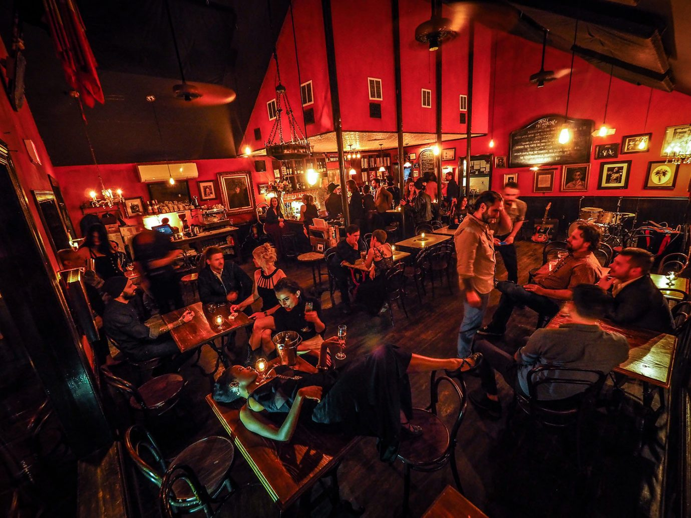 person ceiling people crowd Bar night pub musical instrument accessory restaurant group jazz club tavern recreation several