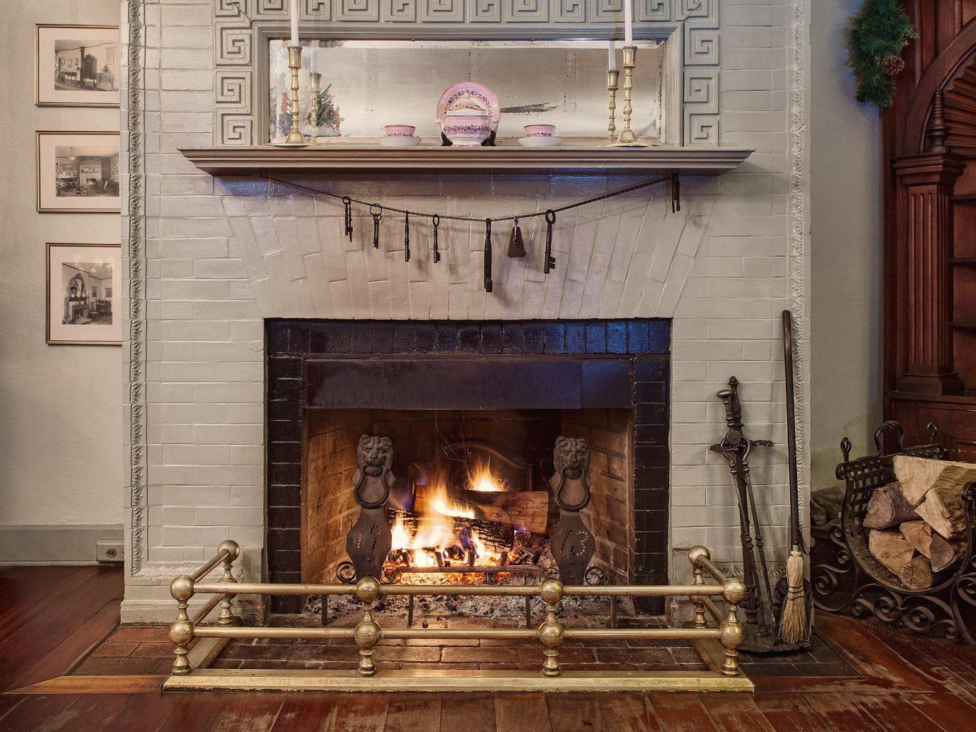 Romance Trip Ideas Fireplace fire indoor floor Living hearth room wood burning stove interior design living room home furniture flooring stone