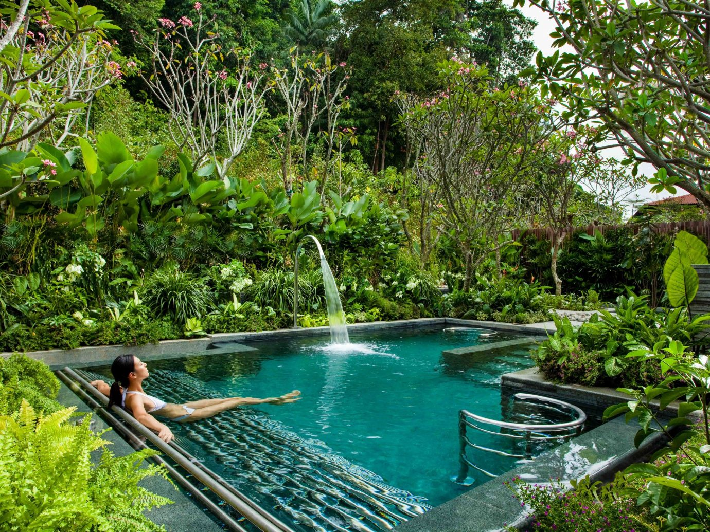 Arts + Culture Singapore Southeast Asia Trip Ideas swimming pool vegetation nature reserve leisure water water resources plant pond Resort watercourse backyard water feature tree estate resort town Garden outdoor structure yard Jungle landscape reflecting pool amenity grass landscaping
