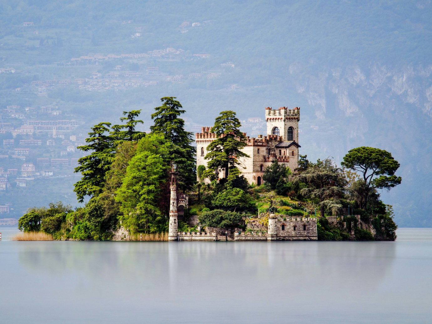 europe Italy Off-the-beaten Path Trip Ideas Nature landmark historic site tourist attraction sky reflection archaeological site tree reservoir Lake tourism mount scenery promontory water islet