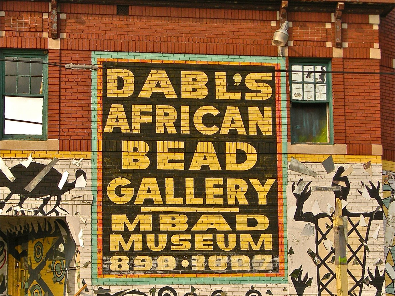 Detroit Influencers + Tastemakers Trip Ideas yellow wall advertising poster facade window font art signage pattern house