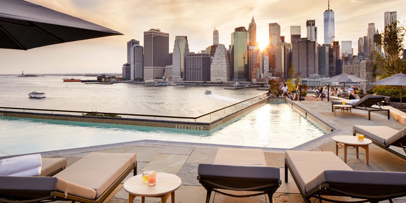 Food + Drink NYC sky table water condominium Architecture swimming pool reflection real estate apartment hotel building roof penthouse apartment City interior design Downtown cityscape window skyline