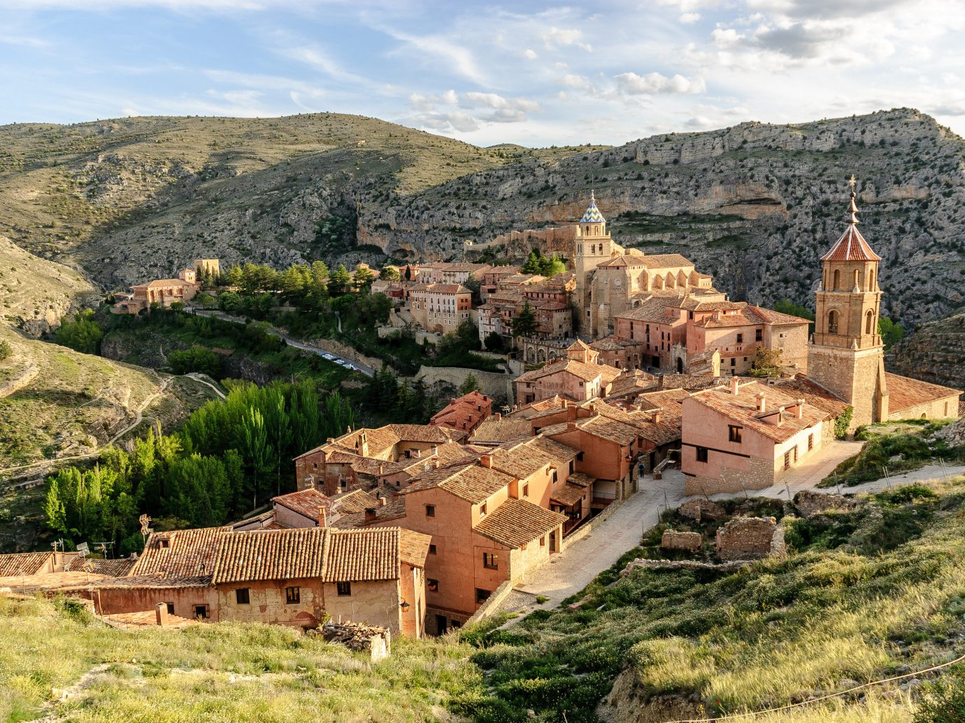 europe Spain Trip Ideas mountain grass outdoor sky mountain village valley Village canyon Nature rock rural area historic site ancient history tourism hill middle ages tree landscape escarpment medieval architecture monastery estate archaeological site hillside