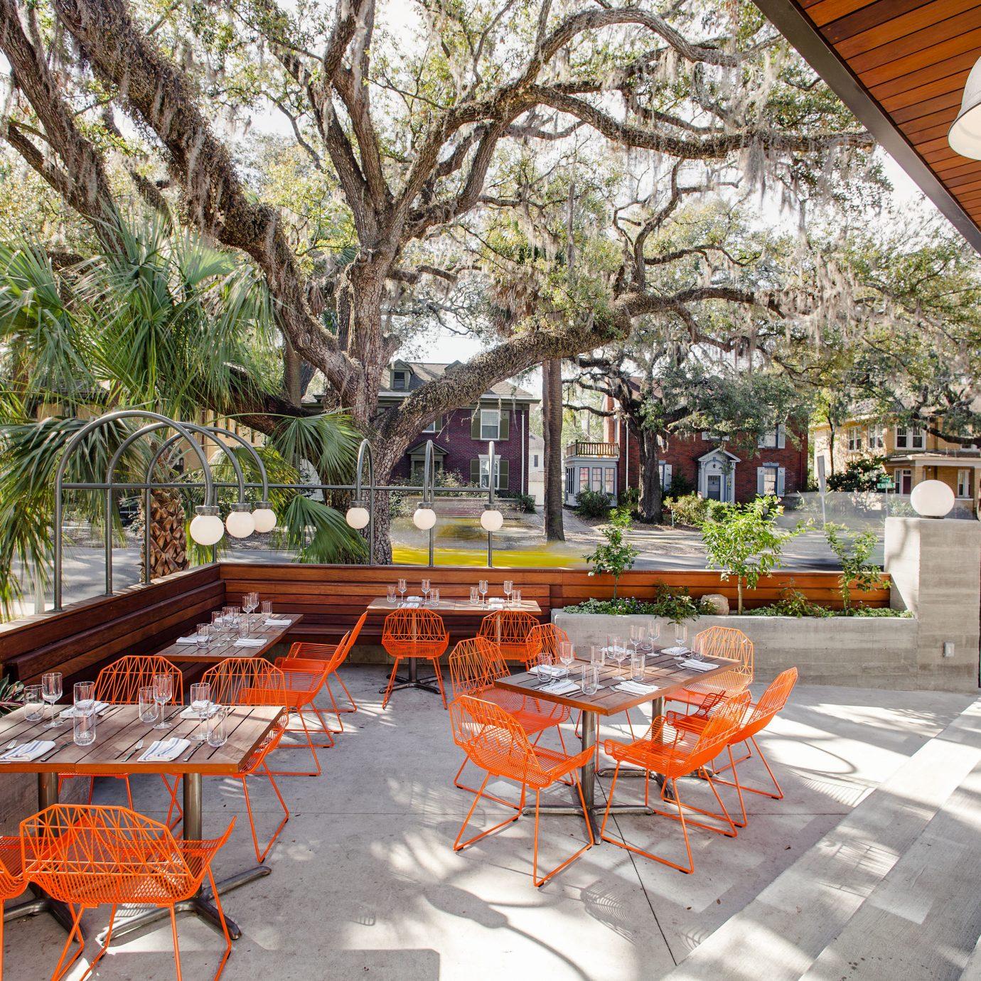 Girls Getaways Trip Ideas Weekend Getaways tree plant table outdoor structure real estate Courtyard mixed use Resort Patio urban design leisure