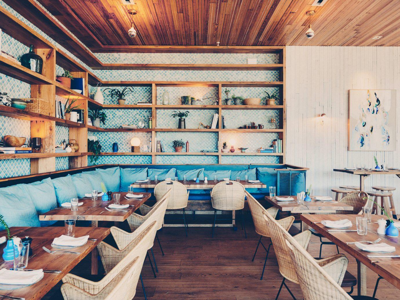 table indoor floor room restaurant wooden interior design estate function hall furniture wood