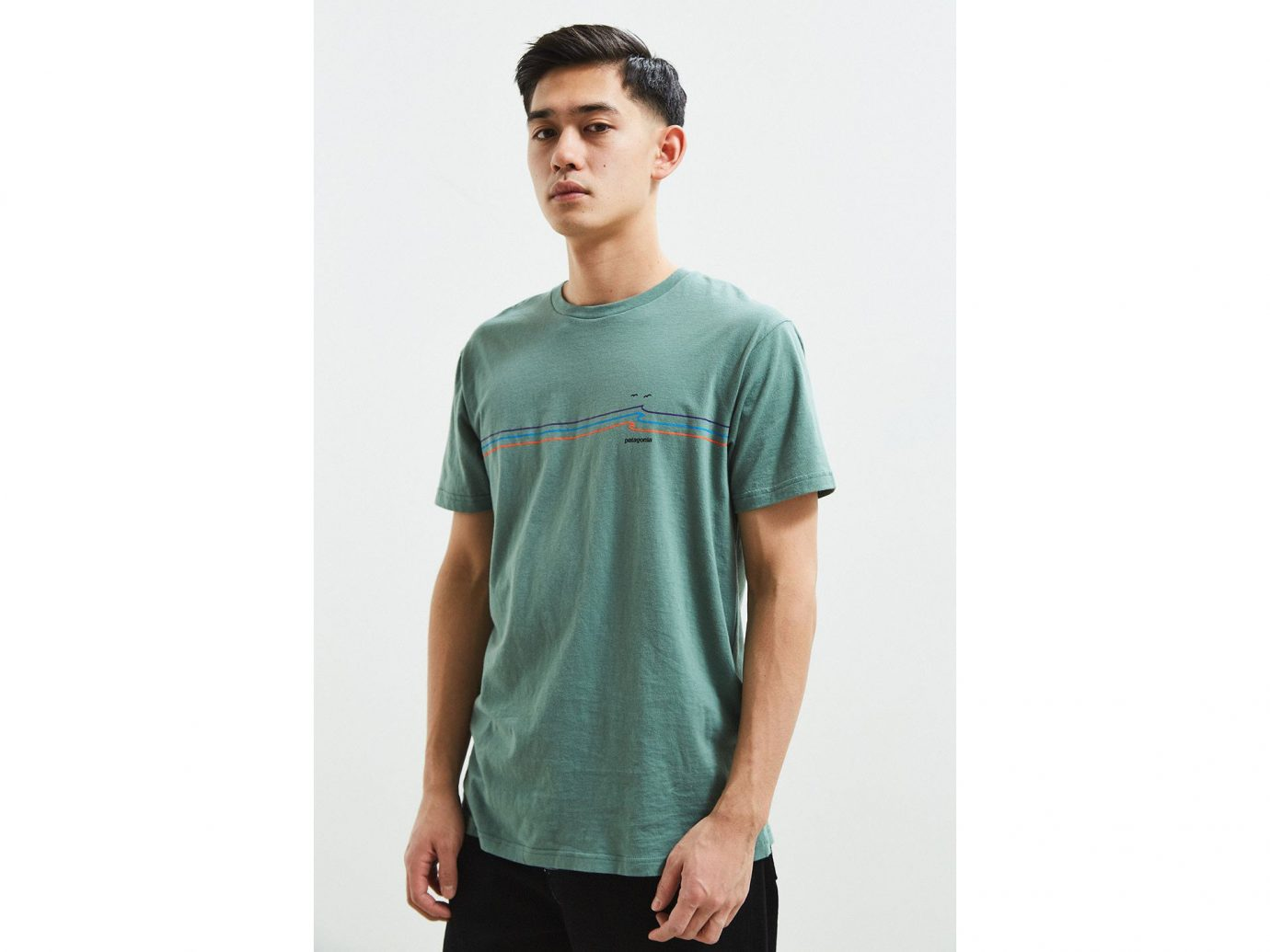 Spring Travel Style + Design Summer Travel Travel Shop person standing t shirt man sleeve shoulder green neck posing product pocket long sleeved t shirt trouser male