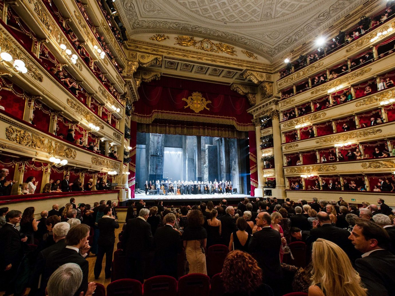 Arts + Culture Italy Milan crowd audience Entertainment auditorium opera house theatre night stage
