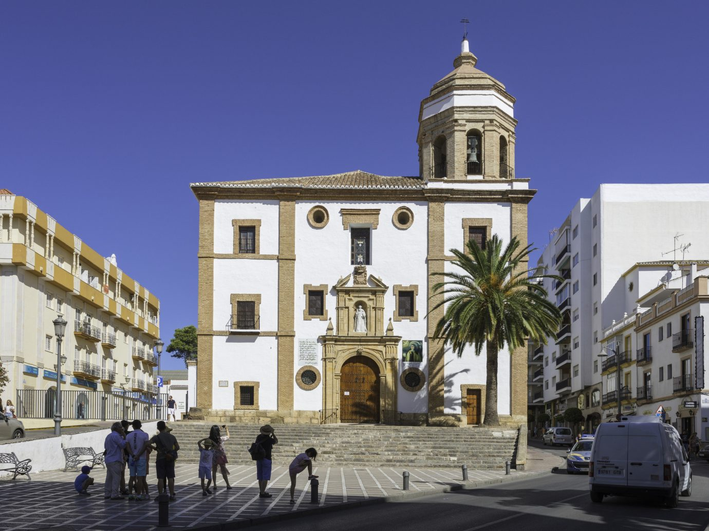 europe Spain Trip Ideas sky building landmark Town town square classical architecture City metropolitan area Church basilica neighbourhood plaza place of worship facade metropolis medieval architecture bell tower street window steeple arch cathedral historic site Downtown tourism