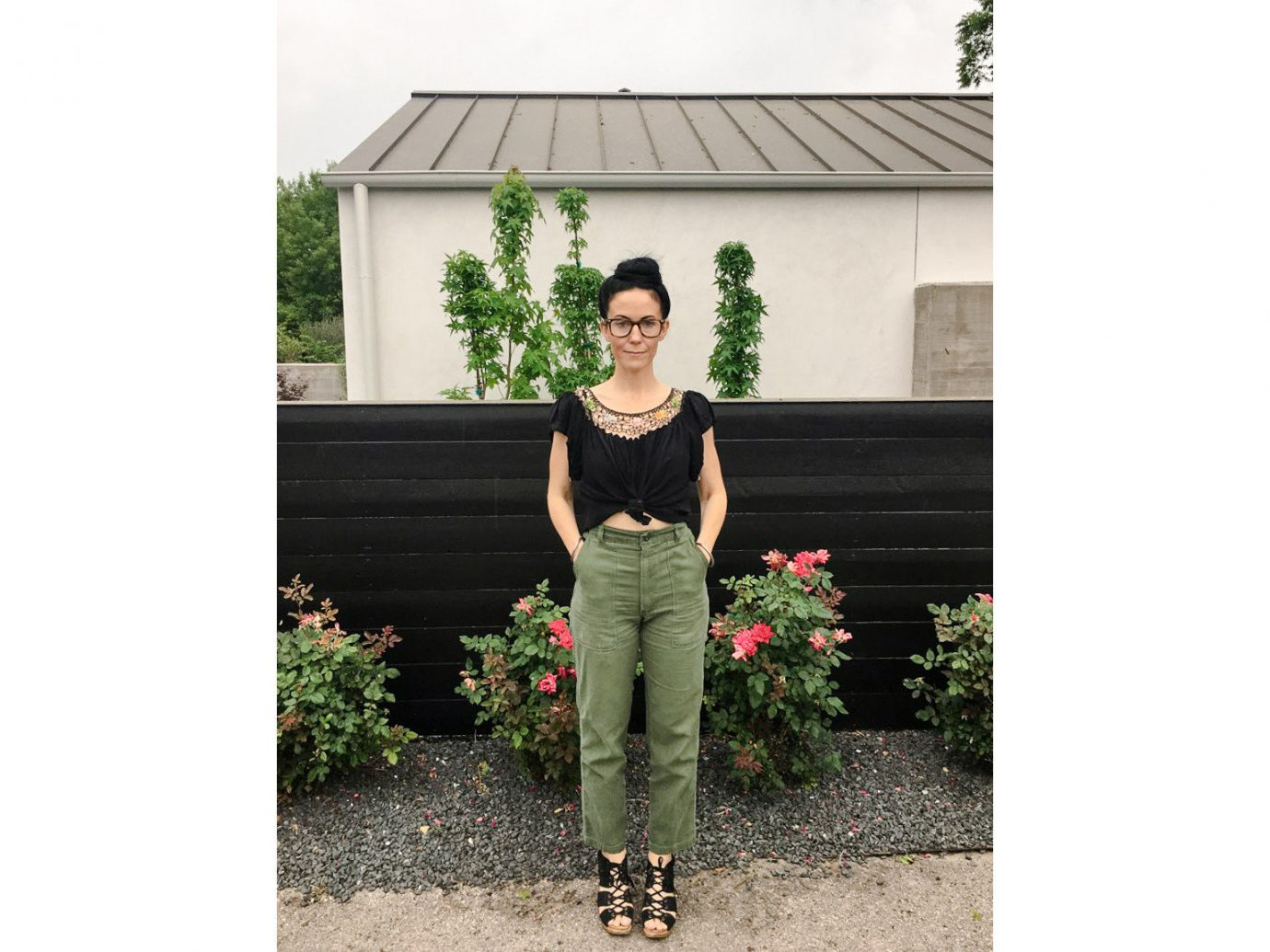 building outdoor green person plant fashion house outerwear tree posing grass flower pattern