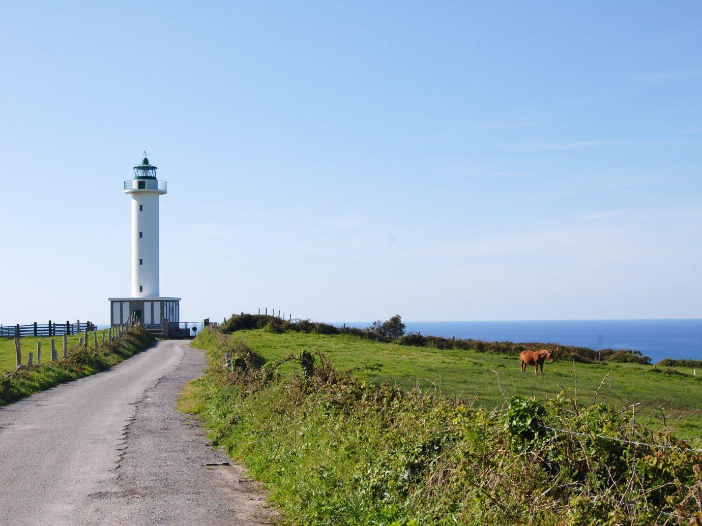 europe Spain Trip Ideas lighthouse Coast sky promontory tower Sea beacon headland shore grass horizon cape land lot Ocean