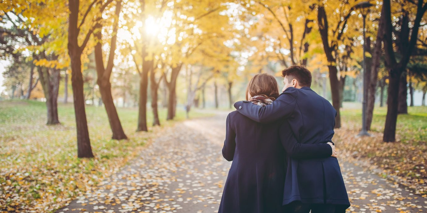 Couple taking a walk in a park at autumn, What to wear on a first date