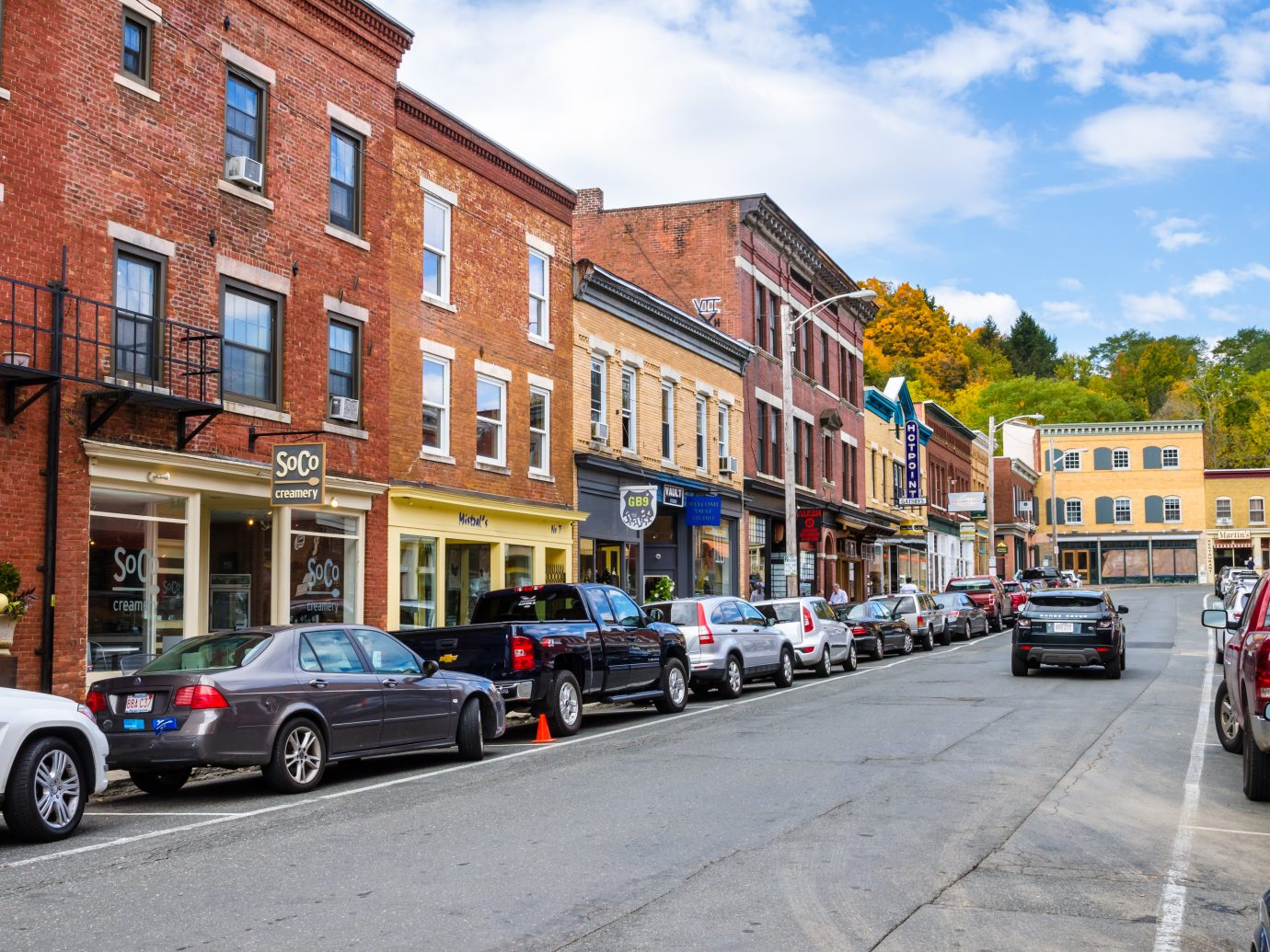 Great Barrington, MA - October 17, 2016: Traditional Brick Buildings with Colourful Shops and Restaurants along Railroad Street. Great Barrington, located within the valley of the Housatonic River, is both a summer resort and home to Ski Butternut.