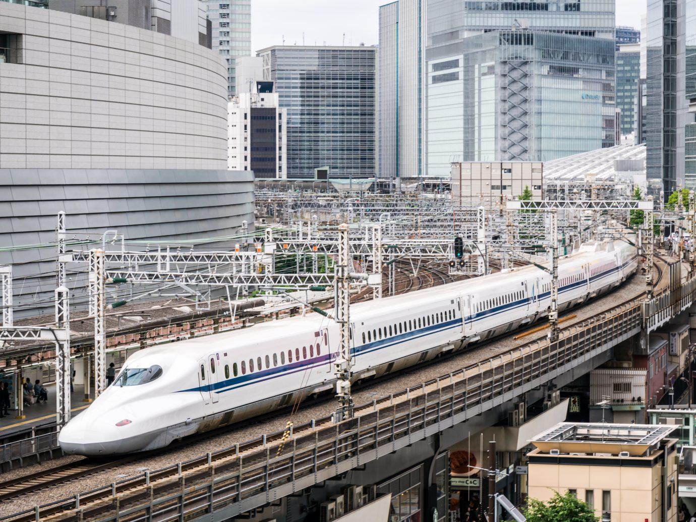Tokyo, Japan - May 14, 2017: High angle view of a Tokaido Shinkansen bullet train speeding through downtown Tokyo.
