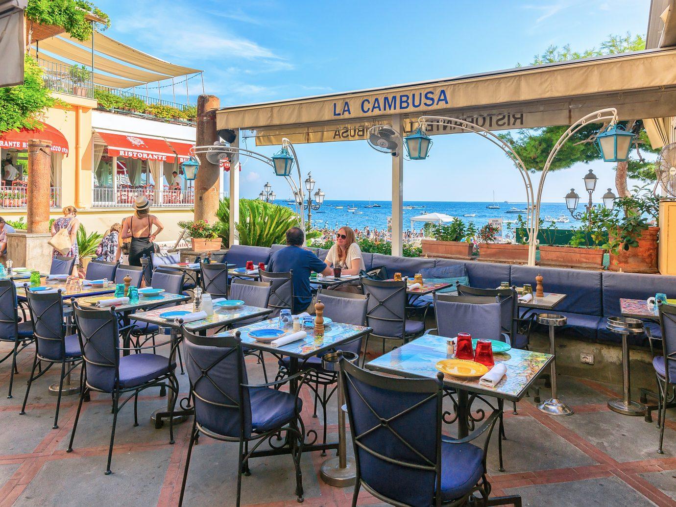 Street terraced cafe in Positano town and Tyrrhenian sea in Amalfi coast, Italy