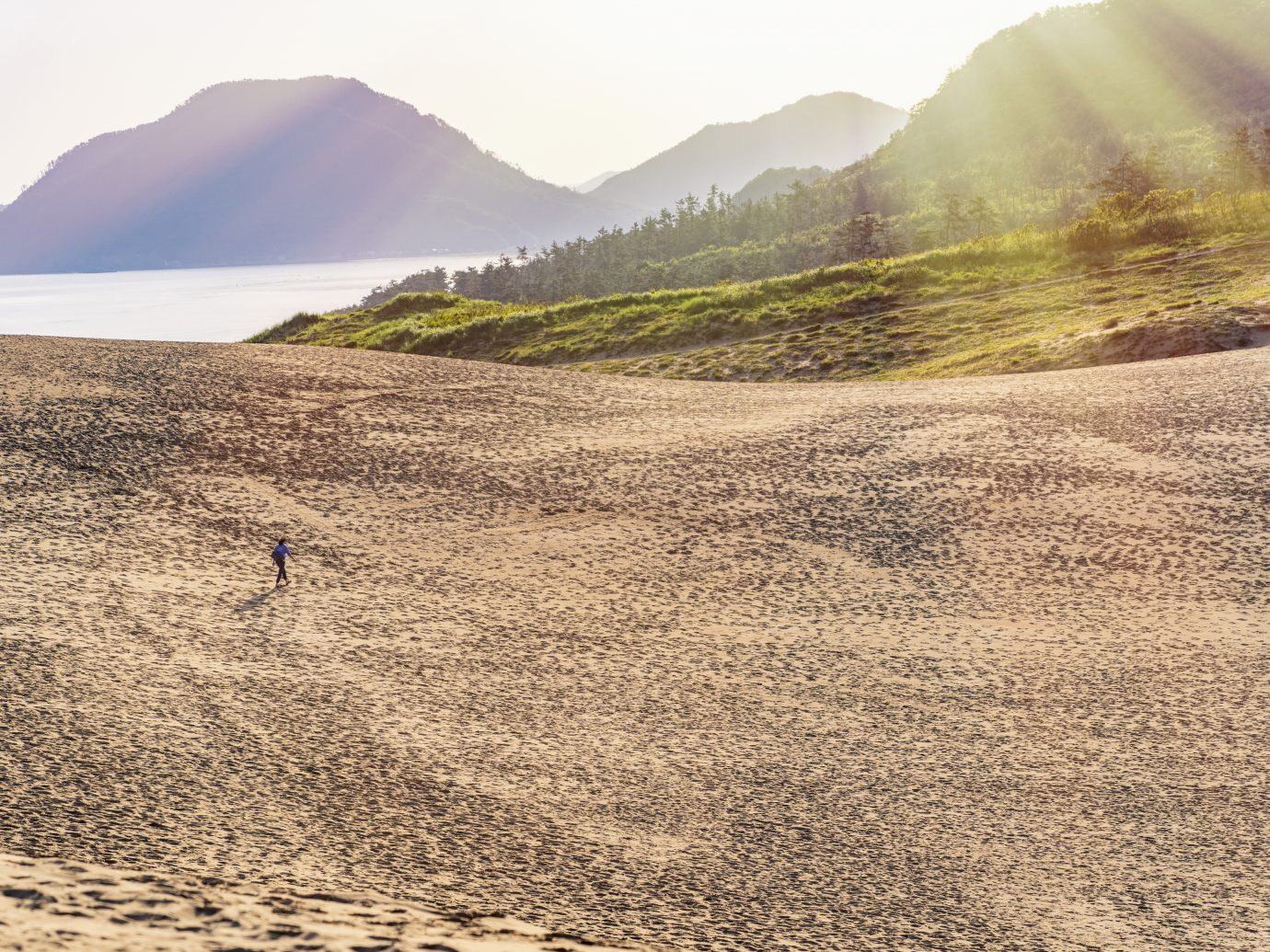 A woman enjoys traveling in a sand dune in Tottori prefecture