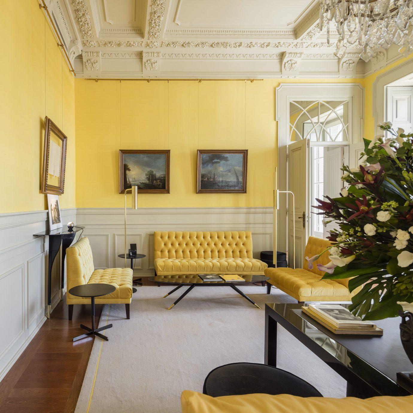 Luxurious room with bright yellow decor at Verride Palácio Santa Catarina