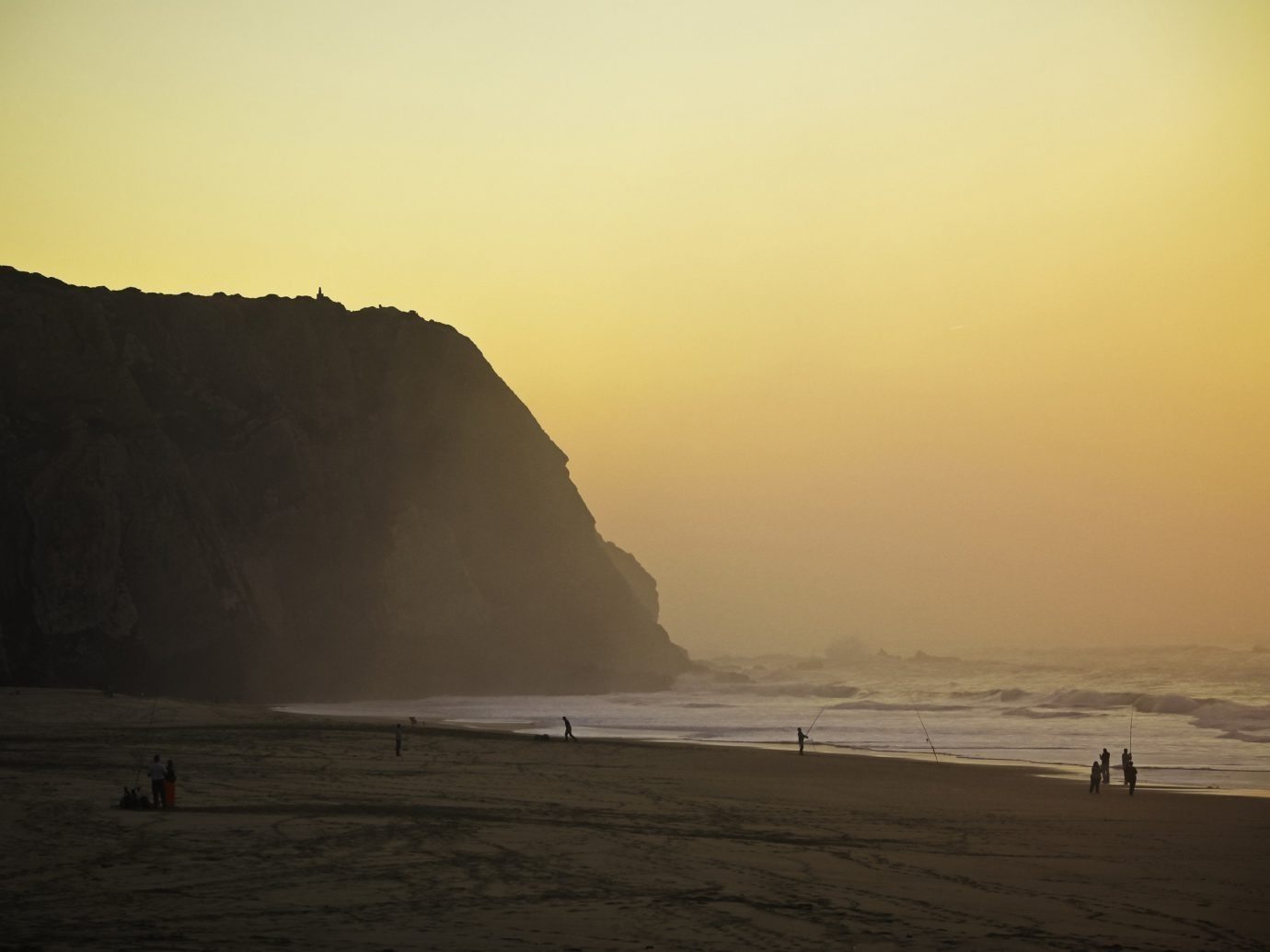 Fishing at Sintra beach during sunset