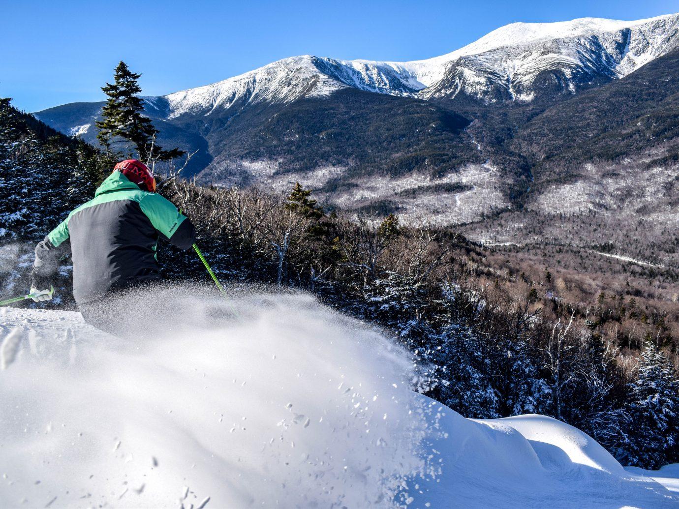Man skiing down slopes at Wildcat Mountain