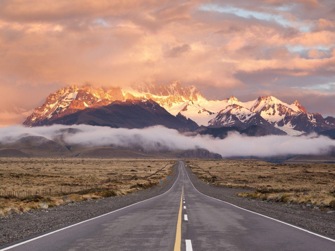 Pink sunset behind a mountain range in Patagonia