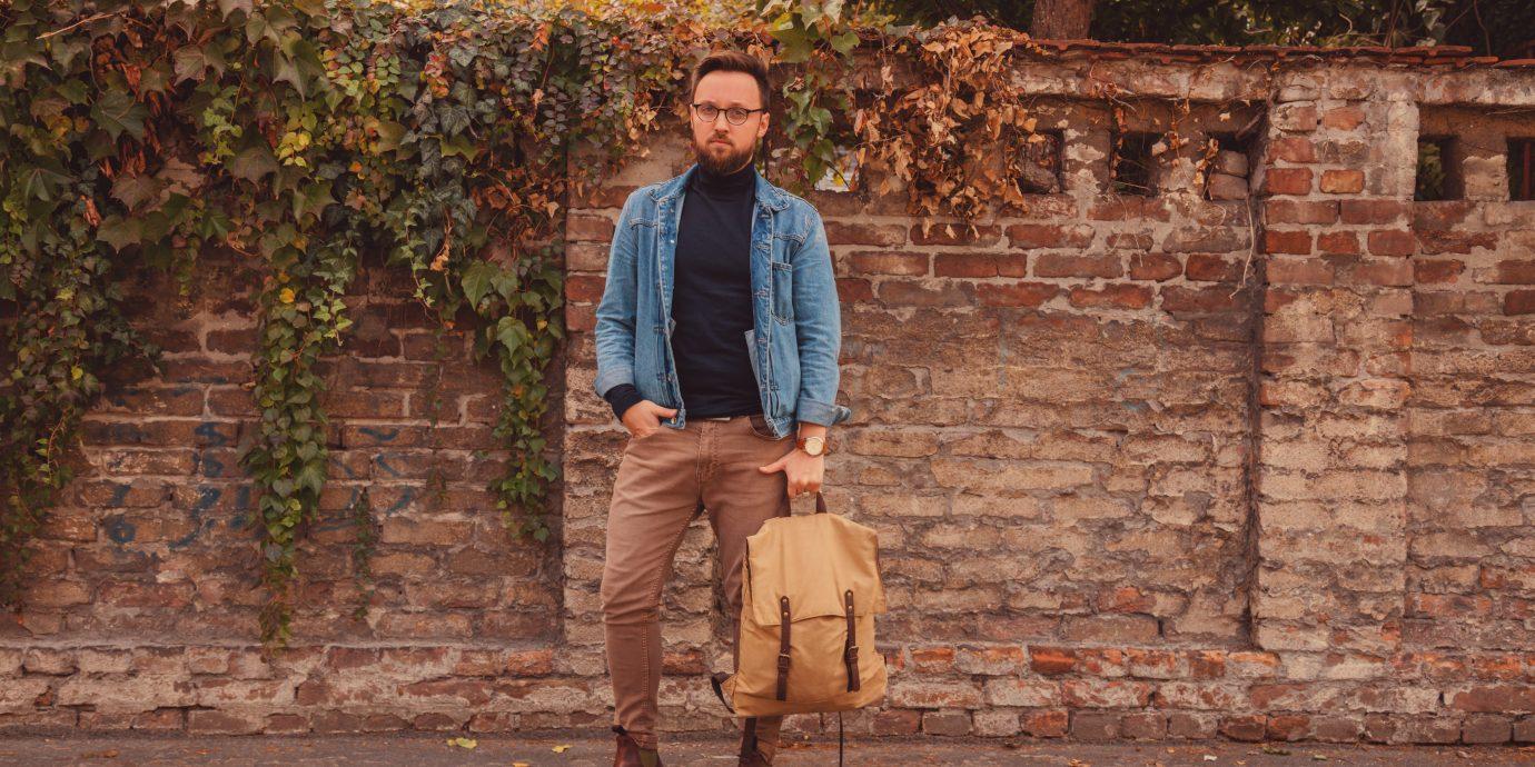 man posing on autumn street.