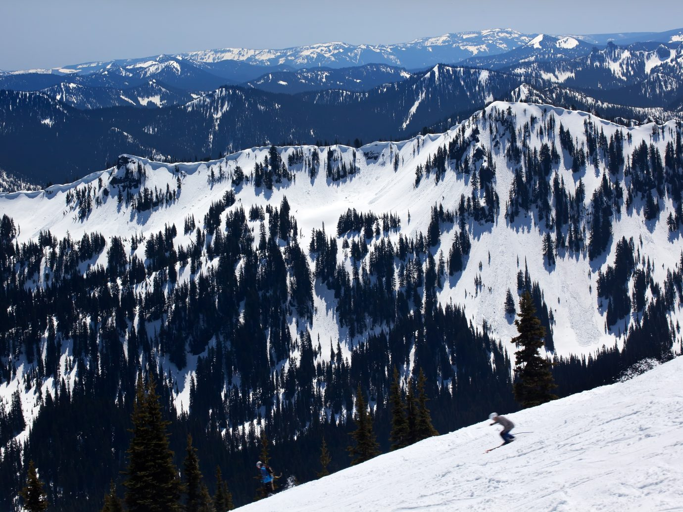 Man skiing on a snowy scape at Crystal Mountain
