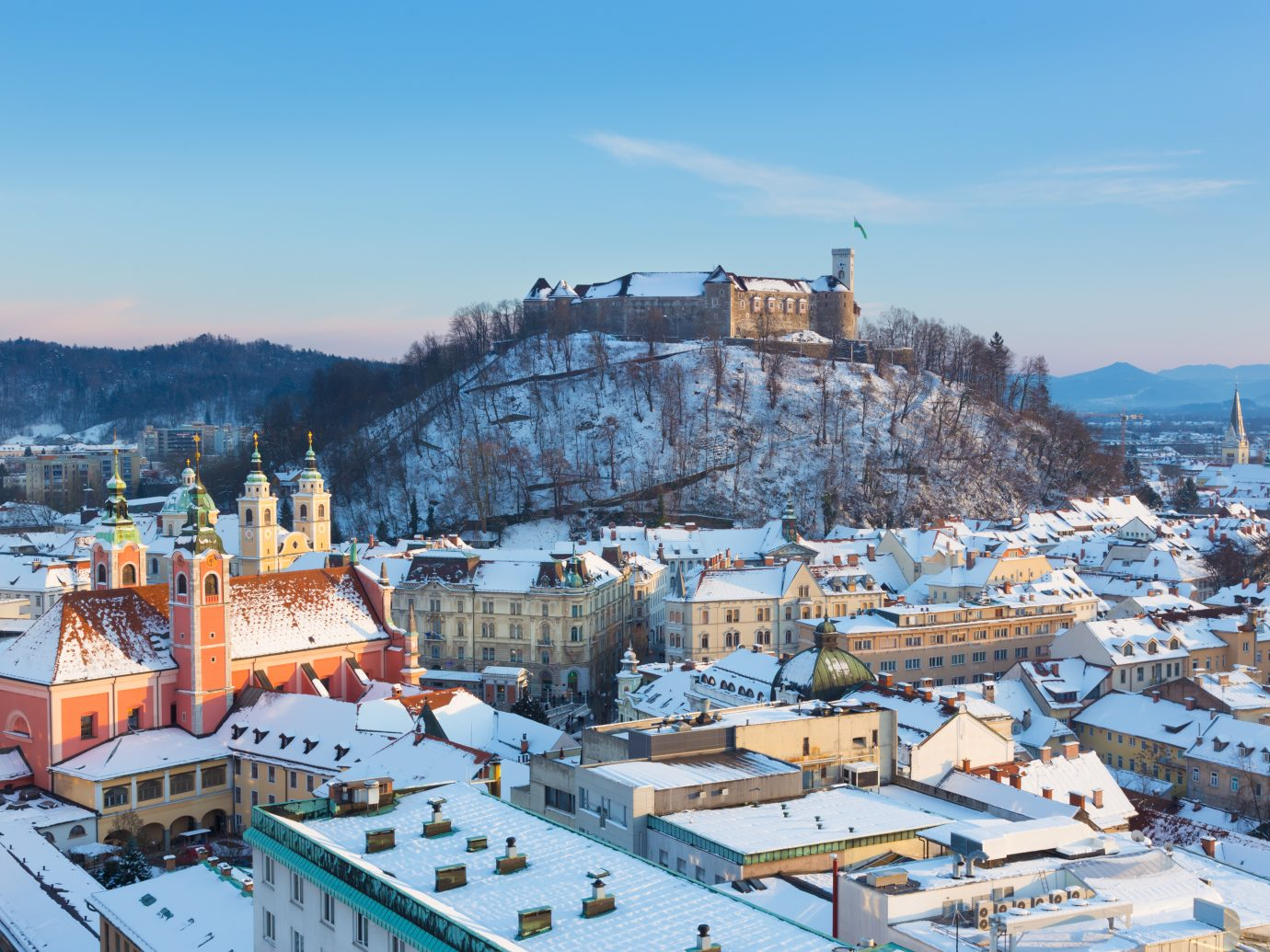 Panoramic view of Ljubljana, capital of Slovenia. Roofs covered in snow in winter time.