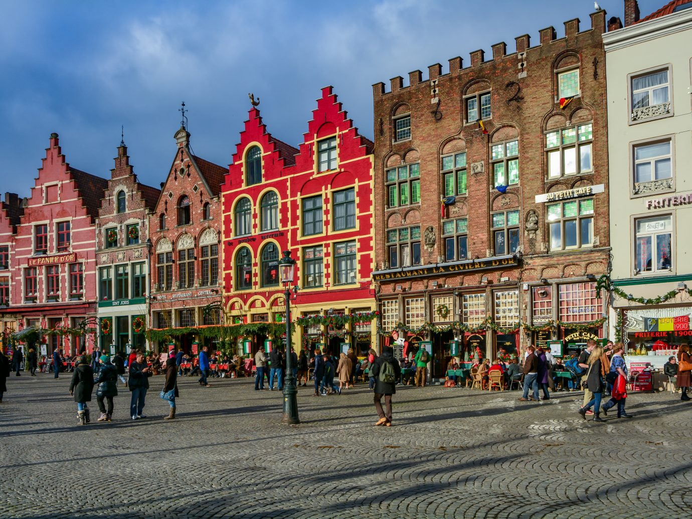 Medieval style buildings near the market place (Grote Markt) in Bruge. Bruge is the capital city of the province of West Flanders in the Flemish Region of Belgium.