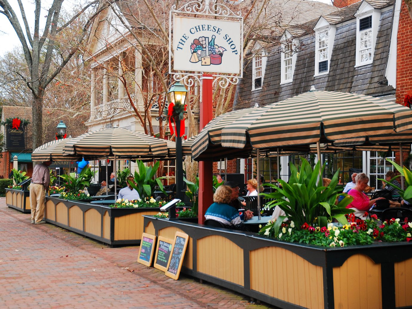 Williamsburg, VA, USA December 6, 2011 a lunch crowd gathers at Merchants Square, a retail and dining area just west of Colonial Williamsburg, Virginia