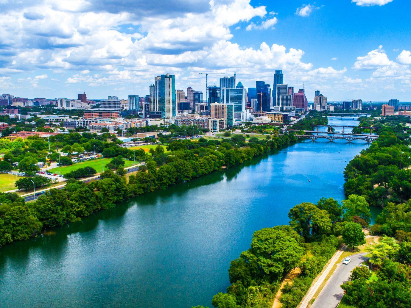 refreshing water with Austin texas skyline background