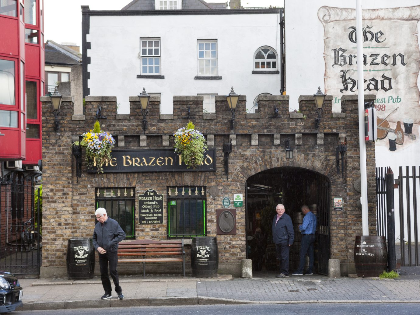 People entering and exiting The Brazen Head pub in downtown Dublin the capital of Ireland. The Brazen Head is billed as Irelands oldest pub and records go back to 1198.
