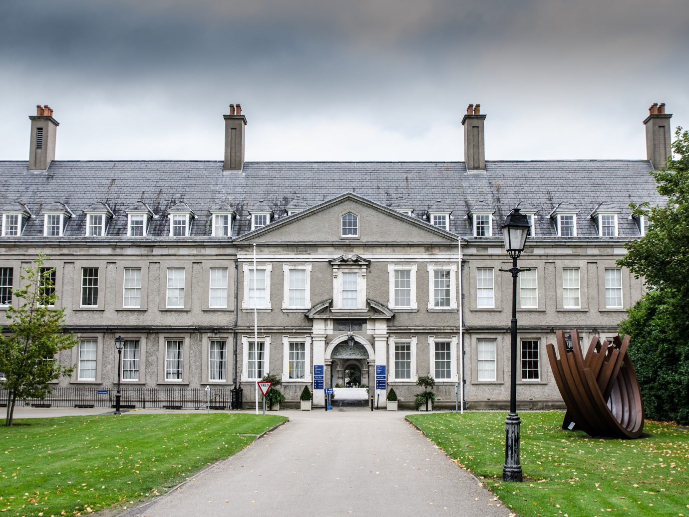 Facade of Dublin Museum of modern art during day of autumn with the foothpath leading to it.