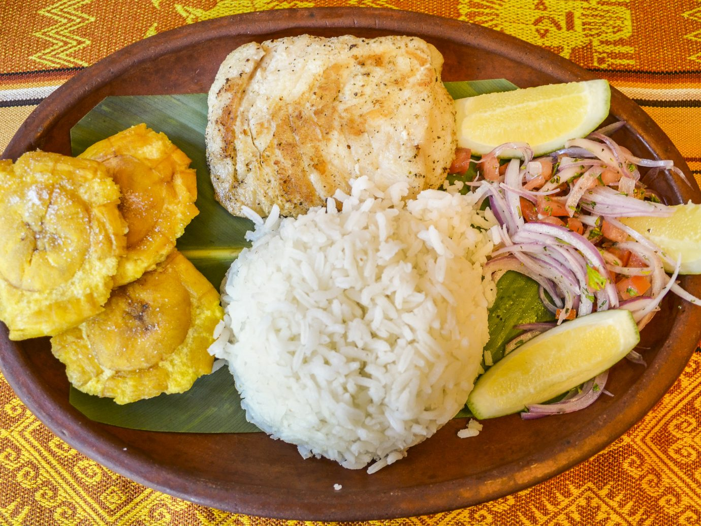 Llapingachos are fried potato cakes that originated in Ecuador. They are usually served with a peanut sauce. The dish is similar to Colombian arepas