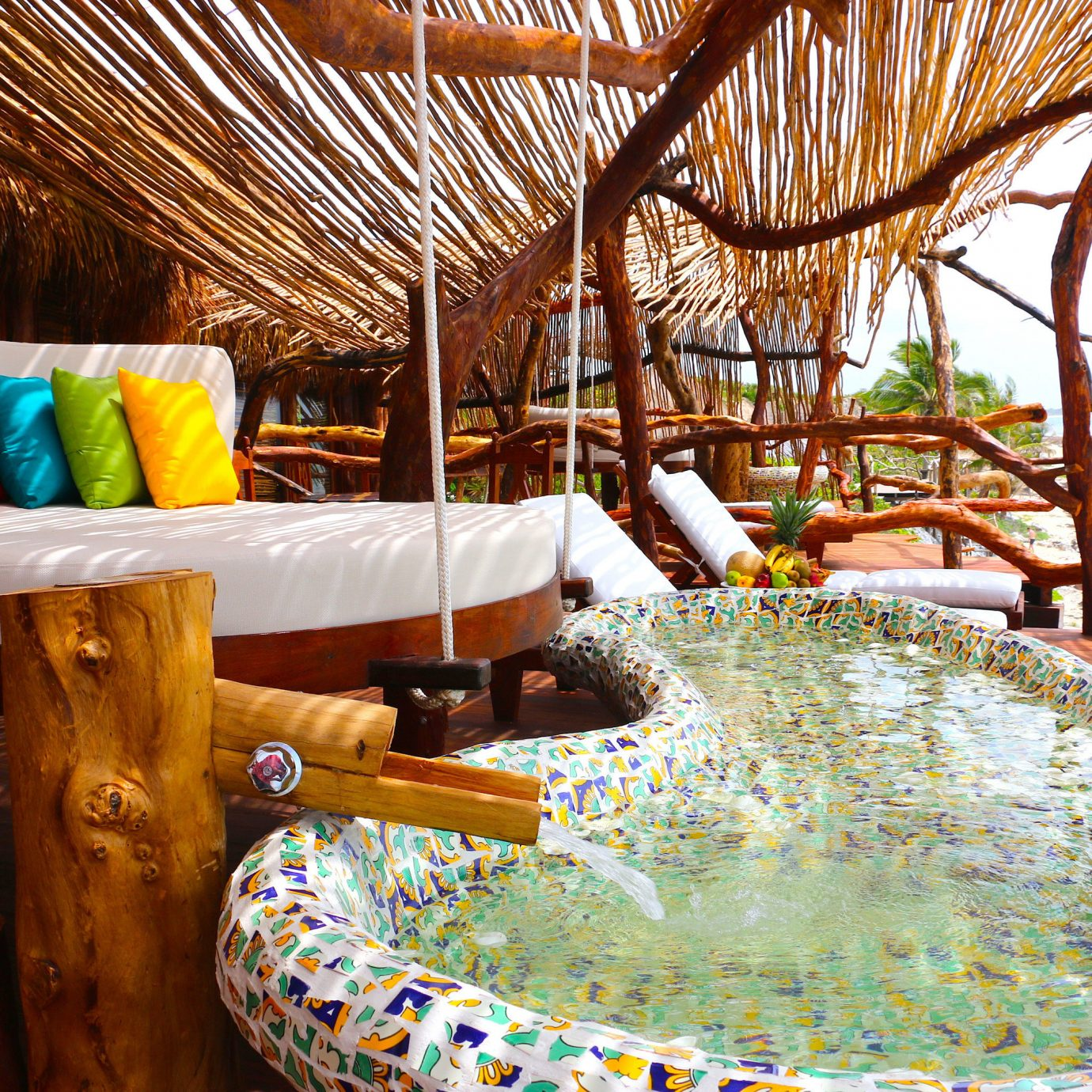 Bed and water at Azulik in Tulum