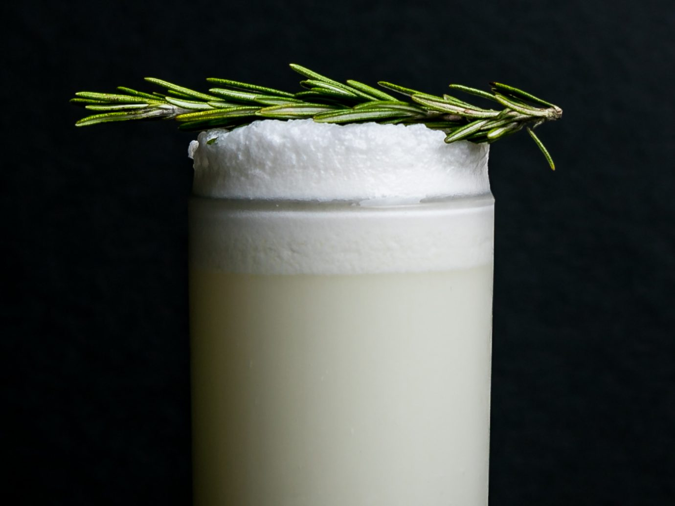 A Sundry + Vice cocktail called The Opal, this is Rhum Agricole, vodka, lemon, lime, sage, lavender, cream, egg white, and a rosemary tincture.