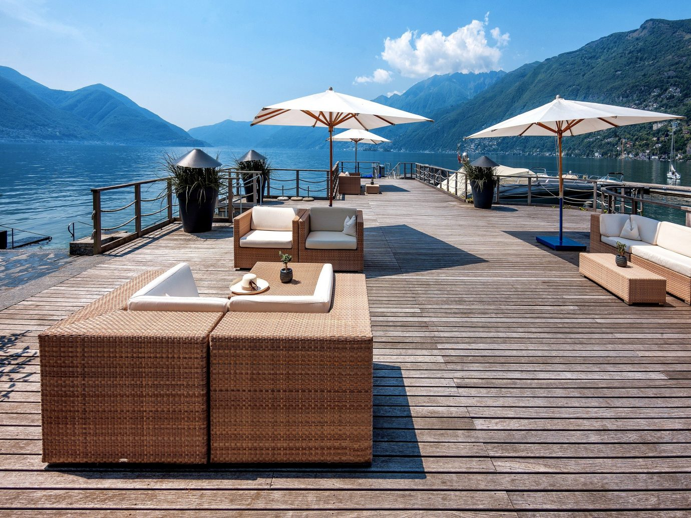 deck with chairs and umbrellas at Hotel Eden Roc