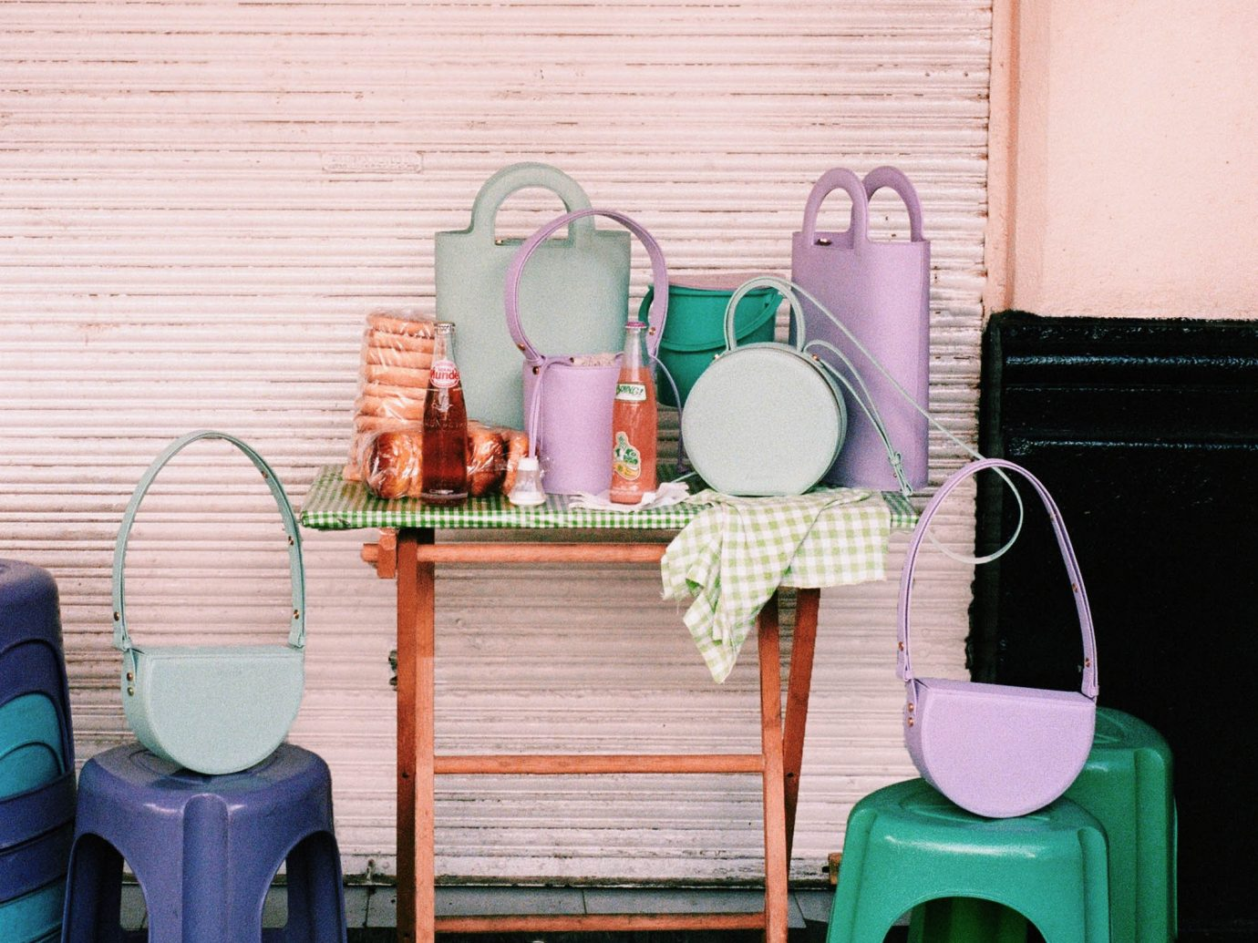 Still life of purses set up in front of a garage