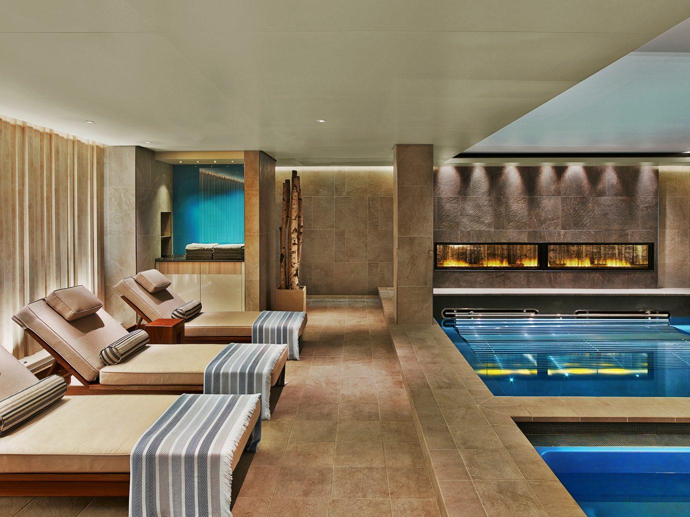 Lounge chairs and heated salt pools inside the Viking Sea Spa
