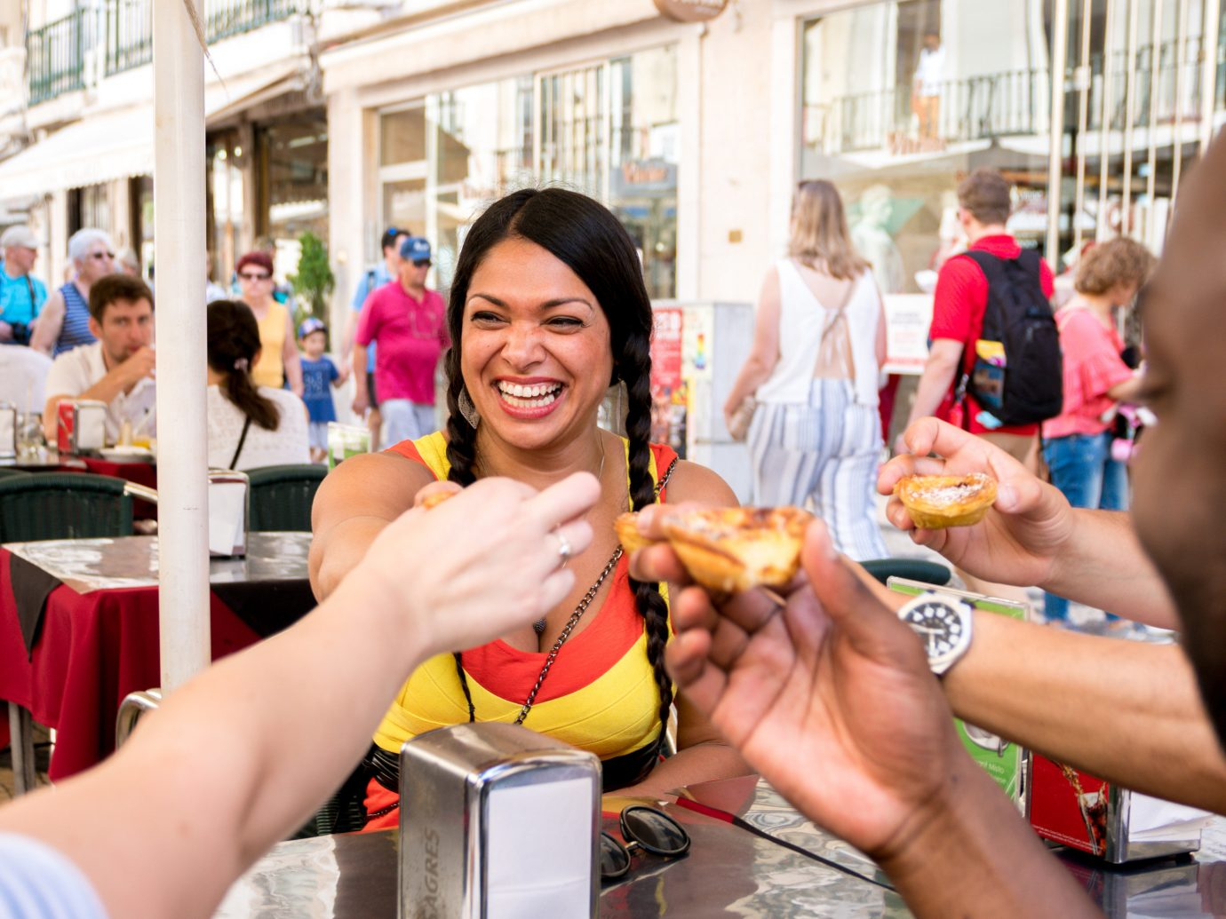 People eating egg tarts in Portugal