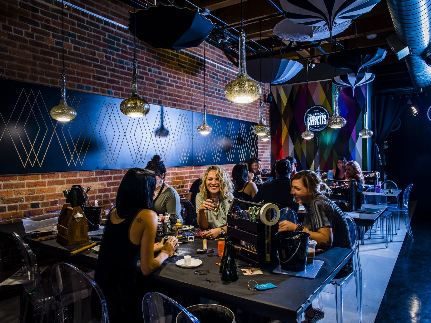 People drinking and crafting at Upstairs Circus
