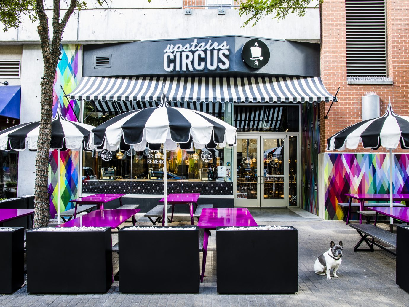 facade and outdoor tables at Upstairs Circus