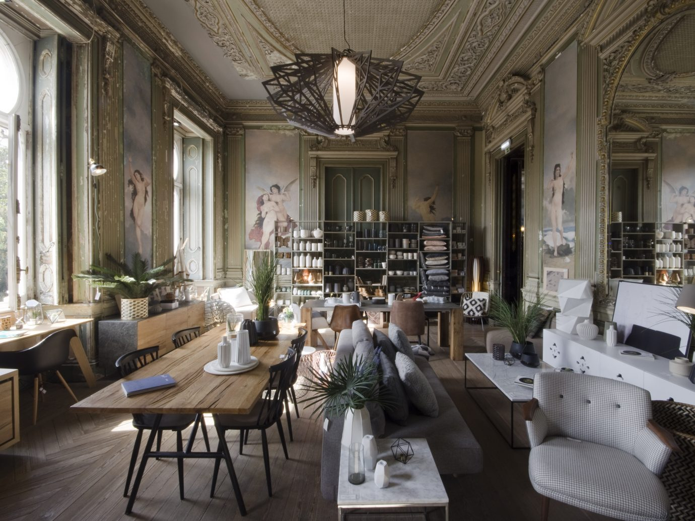 Luxurious interior with nude angel wall paintings and old architecture and modern furniture