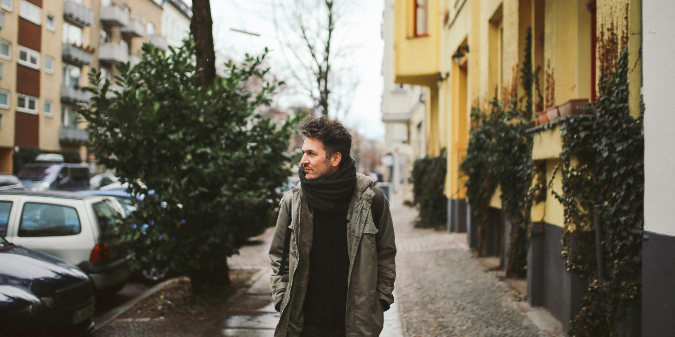 Young man walking in Berlin