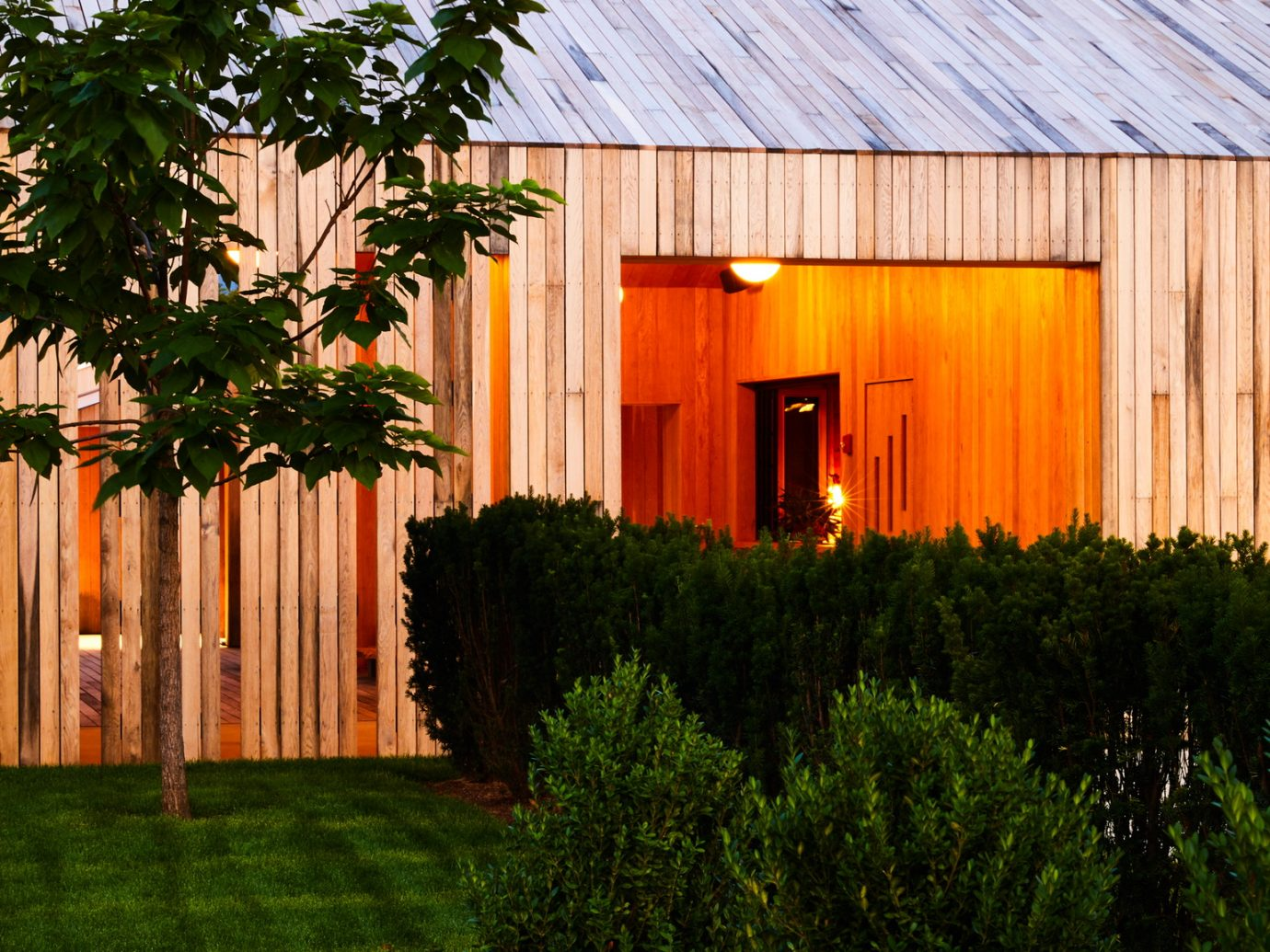 Exterior of TOURISTS at dusk with open barn
