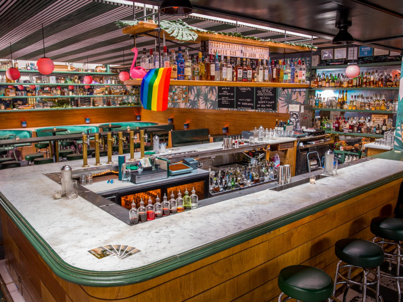 Bar area with gay pride flag at The Happiest Hour in West Village